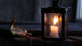 Twelve o'clock o'clock idea. Twelve o'clock idea, Lantern with a candle and antique pocket watch stock video footage
