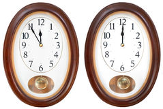 Twelve o clock on oval dial clock Stock Photo