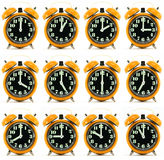 Twelve orange hours alarm clock Royalty Free Stock Image