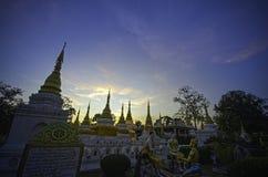 Twelve pagodas yellow blue twilight sky. Yellow blue sky pagoda thailand royalty free stock photo