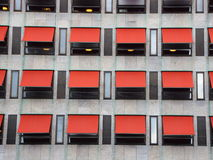 Twelve Red Sunshades on Modern Building Facade Royalty Free Stock Photography