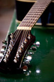 Twelve String Guitar. Close up image highlighting the headstock of an acoustic twelve string guitar Stock Image