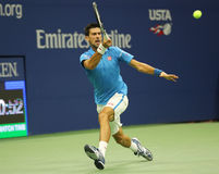 Twelve times Grand Slam champion Novak Djokovic of Serbia in action during his quarterfinal match at US Open 2016 Royalty Free Stock Image
