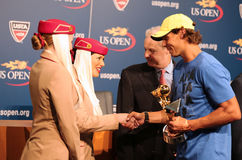 Twelve times Grand Slam champion Rafael Nadal during 2013 Emirates Airline US Open Series trophy presentation Royalty Free Stock Photo