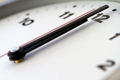 Twelve. 12 on the white wall clocks isolated Stock Image