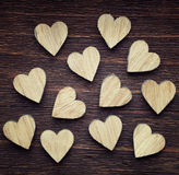 Twelve wooden hearts placed nicely Royalty Free Stock Photos