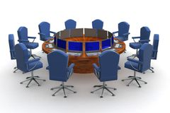 Twelve workplaces behind a round table. Royalty Free Stock Photo