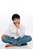 Twelve year old boy sitting, thinking Royalty Free Stock Photo