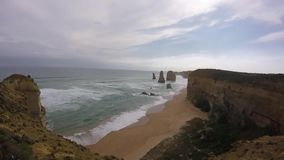 Twelves Apostles, Port Cambell, Australia. Natural cliffs along the great ocean road Very cloudy , sauvage landscapes Victoria, Australia stock video footage