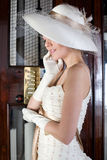 Twenties. Girl inside an elevator with a bridesmaid dress twenties style Royalty Free Stock Photography