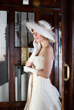 Twenties. Girl inside an elevator with a bridesmaid dress twenties style Royalty Free Stock Photo