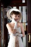 Twenties. Girl inside an elevator with a bridesmaid dress twenties style Stock Photography
