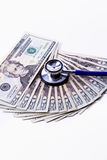 Twenties fanned out with a stethoscope. Stock Photo