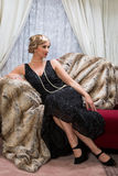 Twenties lady. Color photo with reenactment of a vintage scene with a lady in the roaring twenties style Stock Photos