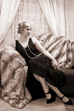 Twenties lady. Reenactment of a vintage scene with a lady in the roaring twenties style Stock Photography