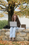 Twenties redhead studying outdoors Royalty Free Stock Image