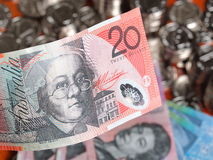 Twenty Australian Dollar note on front of coins Royalty Free Stock Images