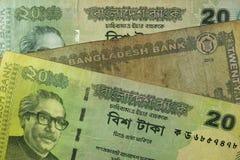 Twenty Bangladeshi taka bills, Bangladesh. Bangladeshi banknotes are among the most dirty, contaminated ones in the world Royalty Free Stock Photo
