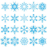 Twenty blue snowflakes on a white background. Royalty Free Stock Photography