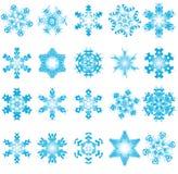 Twenty blue snowflakes on a white background Stock Photo