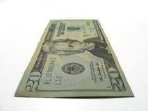 Twenty dollars isolated in white background. Twenty bucks isolated in a white background stock photography