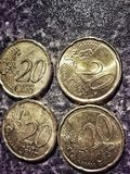 Twenty cents euro coins. Closeup view of four twenty cents euro coins Stock Images