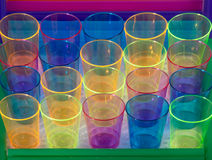 Twenty colored glasses. Stock Photos