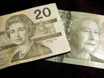 Twenty Dollar Banknotes (Canadian). Close-up of two Canadian twenty dollar banknotes on a black background Stock Images