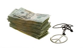 Twenty Dollar Bills next to Peace Sign Necklace Stock Photography