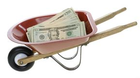 Twenty Dollar Bills in Red Wheelbarrow Stock Photos