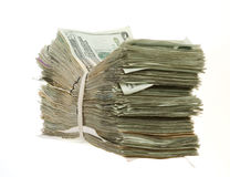 Twenty Dollar Bills Stacked and Banded Together. LArge, tall Bundle of Twenty Dollar Bills Stacked and Banded Together with a Rubber Band isolated on white Stock Photography