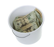 Twenty Dollar Bills in White Cleaning Bucket. US Currency Twenty Dollar Bills in a white cleaning Bucket,  isolated on white background Stock Photography