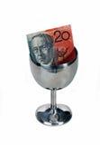 Twenty dollar note. Australian twenty dollar note in a tipping cup Stock Photography