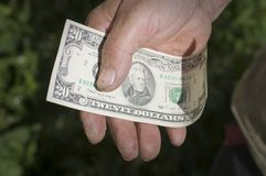 Twenty-dollar note in a man's hand Royalty Free Stock Image