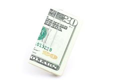 Twenty Dollars. A macro shot of a twenty dollar bill and a paper clip over a white background Stock Photos