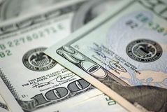 Twenty dollars and hundred dollars closeup Royalty Free Stock Images