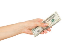 Twenty dollars in the woman`s hand, isolated on white Royalty Free Stock Photography