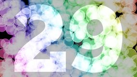 Twenty eight to twenty nine years birthday fade in/out animation with color gradient moving bokeh background.