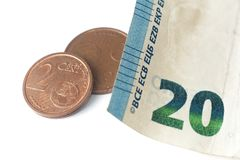 Twenty euro banknote detail and some euro coins. Twenty euro banknote detail and some coins Stock Image