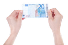 Twenty Euro banknote in female hands Royalty Free Stock Photos