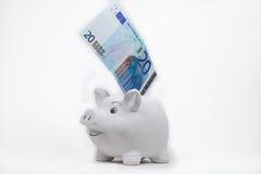 Twenty euro banknote  in a happy piggy bank Royalty Free Stock Photo