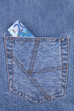 Twenty euro banknote in the jeans pocket Stock Images
