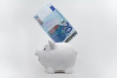 Twenty euro banknote  in a piggy bank Royalty Free Stock Images