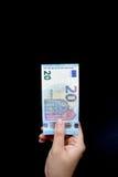 Twenty Euro on hand. For background Royalty Free Stock Photo