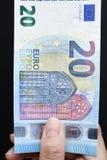 Twenty Euro on hand. For background Royalty Free Stock Photos