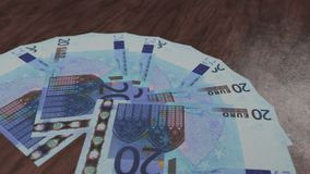Twenty euro money banknotes fan on the wooden floor. royalty free stock image