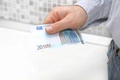 Twenty Euro Paying. Twenty Euro Bill in Man Hand Paying Stock Photography