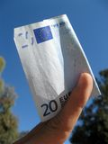 Twenty euros. In hand with sky background Royalty Free Stock Image
