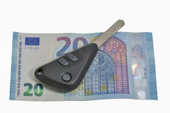 Twenty euros banknote and car keys isolated on white Royalty Free Stock Photos