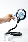 Twenty euros and a magnifying glass Royalty Free Stock Image
